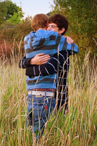 Two guys hugging - Photo Copyright TeeBe